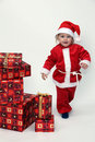 Child with christmas gifts Stock Image