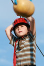Child climbing in adventure playground Royalty Free Stock Images