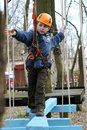 Child climbing in adventure playground. Royalty Free Stock Photography