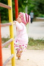 Child climbing on bars Stock Image