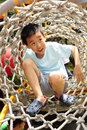 A child climbing a jungle gym. Royalty Free Stock Photo