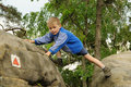 Child climbing rock Stock Images