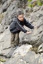 Child Climbing Rock In Nature
