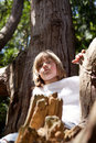 Child climbing tree forest Royalty Free Stock Image