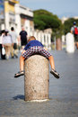 Child clinging to a stone pillar in vatican city is the center of rome italy the small is located st peter s square Stock Photos