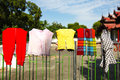 Child clothes and rags drying on a fence Royalty Free Stock Image