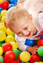 Child in colored ball. Royalty Free Stock Photo