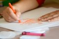 Child Coloring on Blank White Paper with Color Crayons Royalty Free Stock Photo