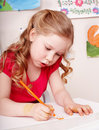 Child with colour pencil draw in preschool. Royalty Free Stock Photography