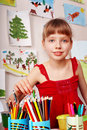 Child  with colour pencil in play room. Royalty Free Stock Photo