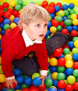 Child in colourful balls. Royalty Free Stock Photo