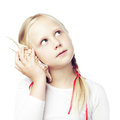 Child communication concept holding a shell to his ear Royalty Free Stock Photography