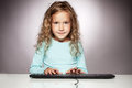 Child with computer keyboard Royalty Free Stock Image