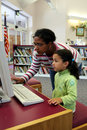 Child on Computer With Teacher Royalty Free Stock Photo