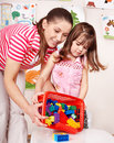 Child with  construction set in play room. Stock Photography