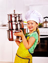 Child cooking at kitchen wearing hat and apron Stock Image