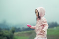 Child cute little girl  running in the garden after rain Royalty Free Stock Photo