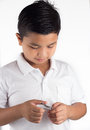 Child cutting finger nails in white backgound for stock images Royalty Free Stock Images