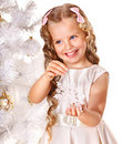 Child decorate Christmas tree. Royalty Free Stock Photos
