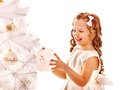 Child decorate white christmas tree isolated Royalty Free Stock Image