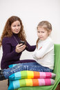 Child with displeasure giving smartphone mother caucasian Royalty Free Stock Photo