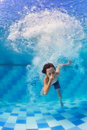 Child diving underwater in swimming pool Royalty Free Stock Photo