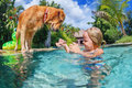 Child with dog dive underwater in swimming pool Royalty Free Stock Photo