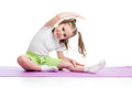 Child doing fitness exercises kid on mat Royalty Free Stock Photos