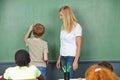 Child doing math in chalkboard elementary school class Stock Image
