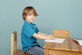 Child drawing learning to write concept of preschool kids education and art in class Royalty Free Stock Photography