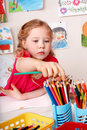Child drawing pencil in play room. Royalty Free Stock Photo