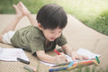 Child drawing picture with crayon Royalty Free Stock Photo