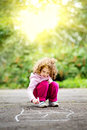 Child draws on asphalt a chalk Royalty Free Stock Images