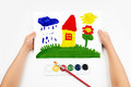 Child draws the home watercolors on paper Royalty Free Stock Photos