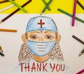 The child draws pencils of a medical worker and the inscription thank you
