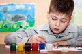 Child draws a picture paints Royalty Free Stock Photos