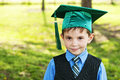 Child dressed for kindergarten graduation wearing cap and tassel formally to graduate Stock Image