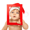 Child dressed in red Christmas hat Royalty Free Stock Photo