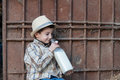 Child drinking a bottle of fresh milk is holding and Royalty Free Stock Photography