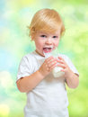 Child drinking dairy product from glass Stock Photos