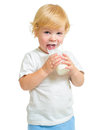 Child drinking dairy product from glass isolated on white Royalty Free Stock Photography