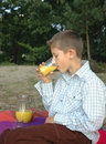 Child drinking juice Royalty Free Stock Photo