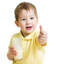 Child drinking milk and showing thumb up or kefir Royalty Free Stock Images