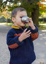Child drinking tea in park Royalty Free Stock Photo