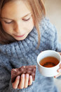 Child drinking tea wearing sweater and at home Royalty Free Stock Photo