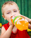Child drinking unhealthy bottled soda Royalty Free Stock Photos