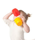 Child drinks juice from a mug. Royalty Free Stock Photo