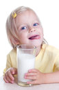 Child drinks milk girl from glass on white background Royalty Free Stock Photography