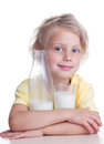 Child drinks milk girl from glass on white background Stock Photo