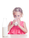 Child drinks milk girl from glass on white background Royalty Free Stock Images